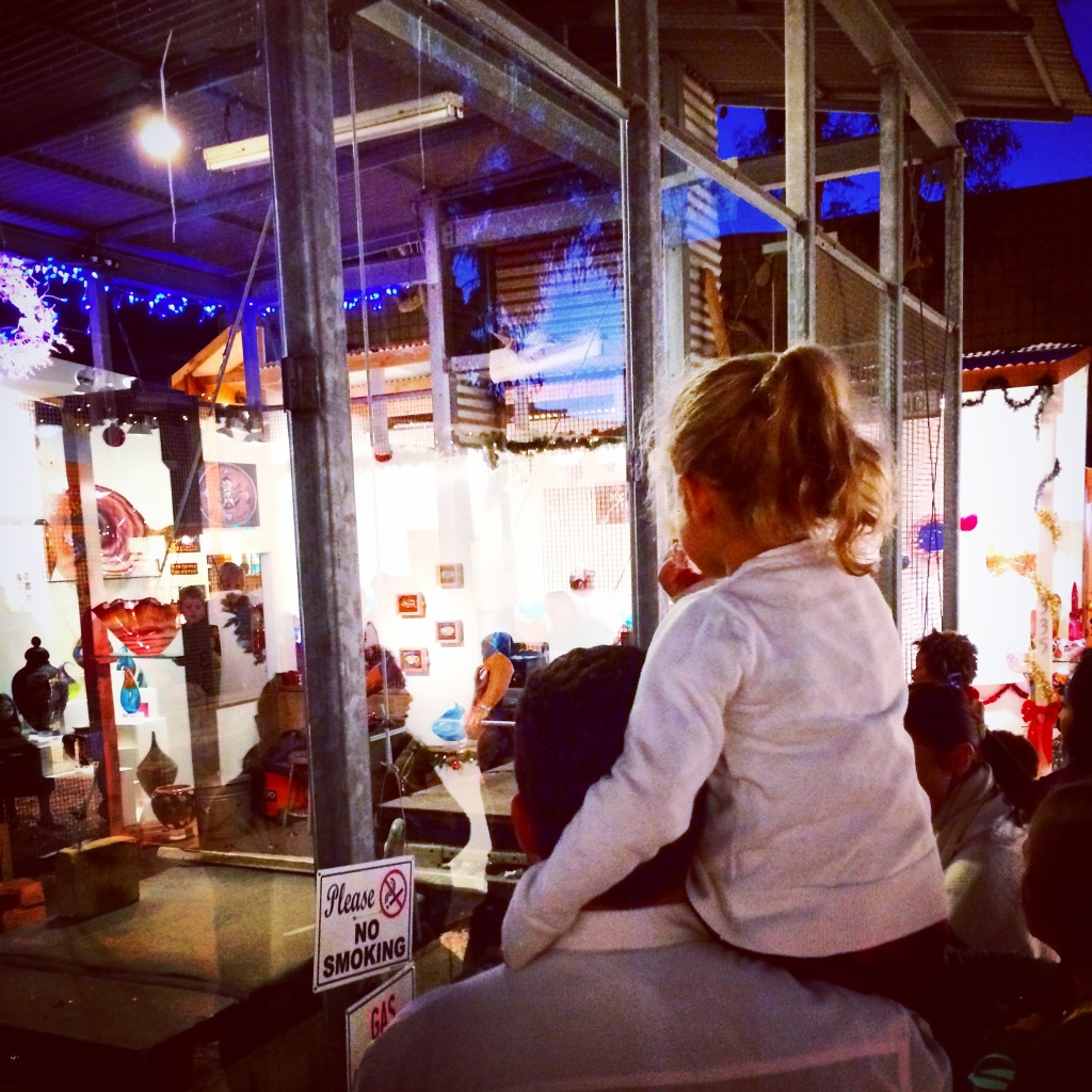 Author's daughter watches the glassblowing demonstration at the Sawdust Art Festival's Winter Fantasy