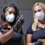 Detective Leslie Jones Bradford and Forensic expert Lori Morgan examining evidence.